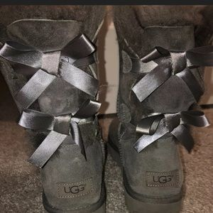 Grey Uggs with cute bows on the back
